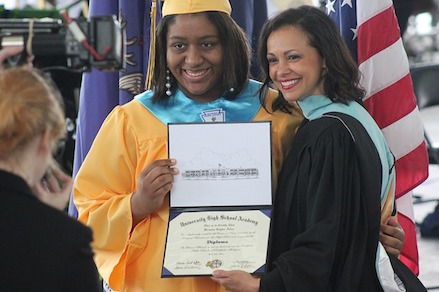 Picture of a student with diploma.